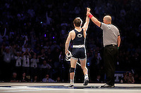 STATE COLLEGE, PA - FEBRUARY 8: Jimmy Gulibon of the Penn State Nittany Lions gets his hand raised after winning his match against Cory Clark of the Iowa Hawkeyes on February 8, 2015 at the Bryce Jordan Center on the campus of Penn State University in State College, Pennsylvania. The Hawkeyes won 18-12. (Photo by Hunter Martin/Getty Images) *** Local Caption *** Jimmy Gulibon