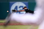 Albuquerque Isotopes' Joey Wong dives for a ball down the third baseline in a game against the Reno Aces in Reno, Nev., on Saturday, April 18, 2015. The Isotopes won 9-4.<br /> Photo by Cathleen Allison