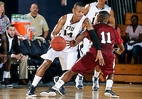 Florida International University guard DeJuan Wright (14) plays against Troy University, which won the game 75-70 in overtime on February 23, 2012 at Miami, Florida. .