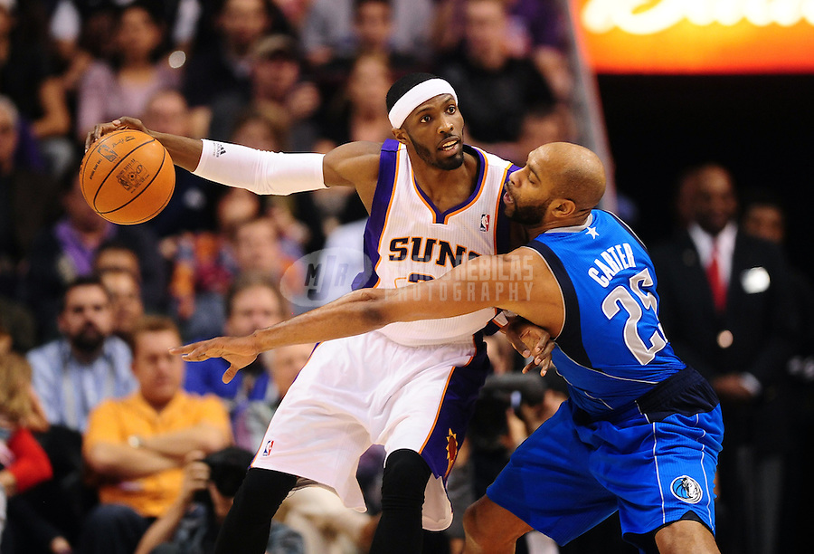 Jan. 30, 2012; Phoenix, AZ, USA; Phoenix Suns forward Hakim Warrick (left) drives to the basket against Dallas Mavericks guard (25) Vince Carter in the first half at the US Airways Center. The Mavericks defeated the Suns 122-99. Mandatory Credit: Mark J. Rebilas-