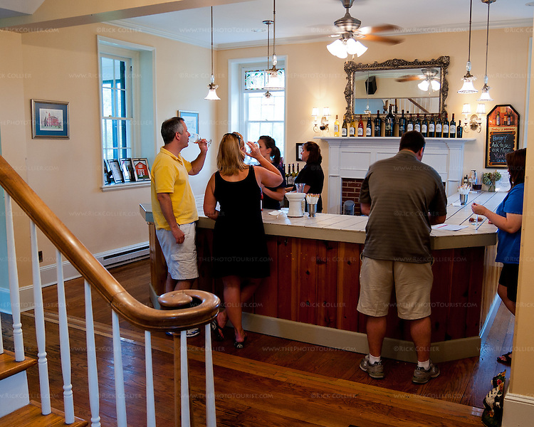 Visitors taste wine at the bar in The Winery at La Grange.