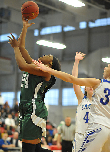 Kem Nwabudu #24 of Elmont drives to the net during the Class A Long Island Championship against Hauppauge at Suffolk County Community College Grant Campus in Brentwood on Thursday, March 8, 2018. Elmont won by a score of 56-30.