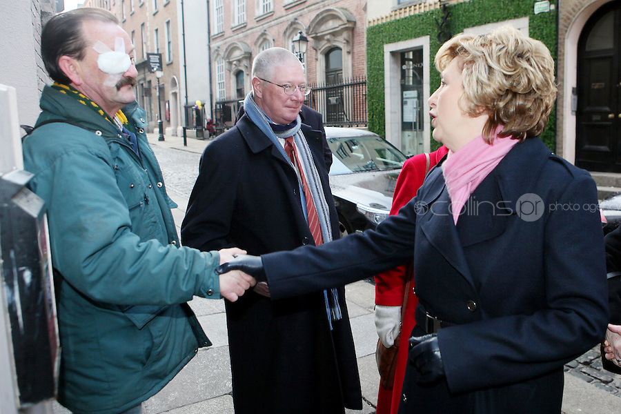 NO REPRO FEE. President McAleese has visited the Focus Ireland Coffee Shop.20/12/2010. President Mary McAleese speaks to John Paul O Reilly a customers the Focus Ireland Coffee Shop and Housing Advice Service in Temple Bar. The Centre provides meals, advice, information and support to the homeless.Picture James Horan/Collins Photos