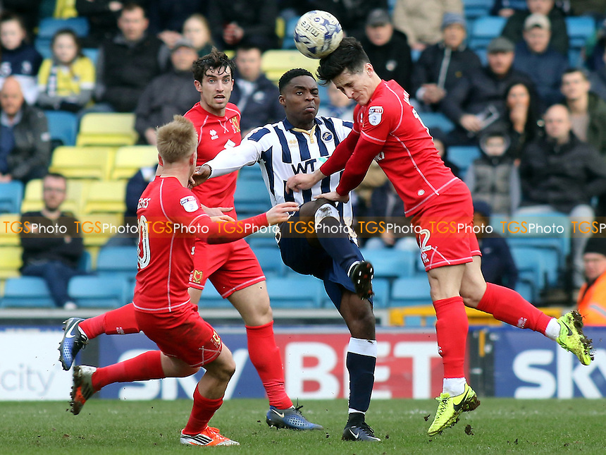 George Williams of MK Dons heads the ball away during Millwall vs MK Dons, Sky Bet EFL League 1 Football at The Den on 4th March 2017