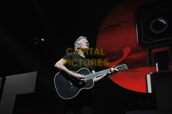 Roger Waters performing 'The Wall' in its entirety at Birmingham NIA (National Indoor Arena), England..27th June, 2011.on stage gig concert live performance music half length guitar black t-shirt jeans denim singing .CAP/MAR.© Martin Harris/Capital Pictures.