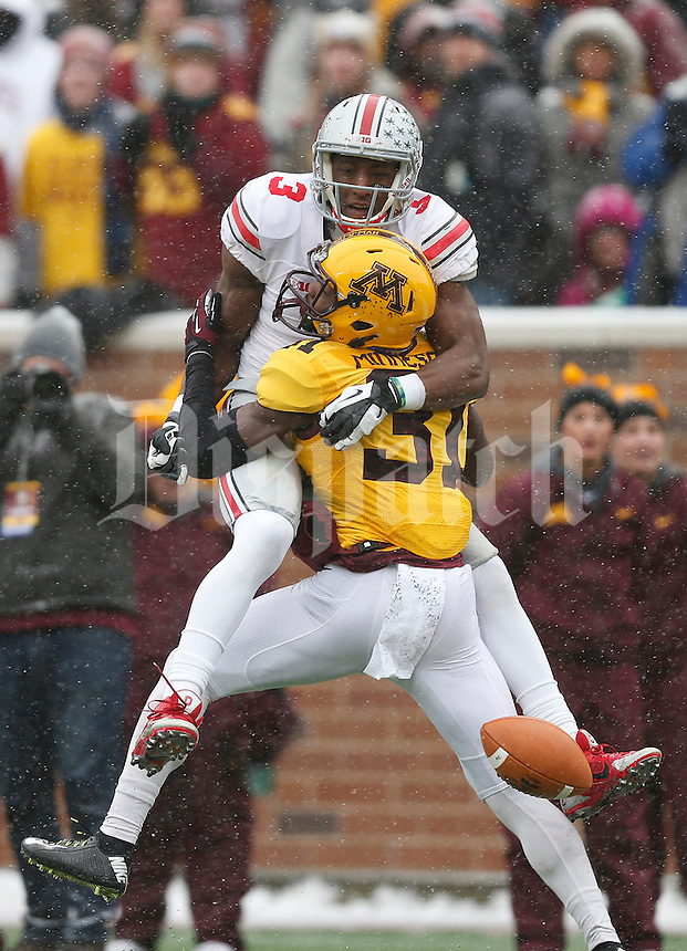 Minnesota Golden Gophers defensive back Eric Murray (31) gets called for a pass interference on Ohio State Buckeyes wide receiver Michael Thomas (3) in the end zone during the second quarter of the college football game between the Ohio State Buckeyes and the Minnesota Golden Gophers at TCF Bank Stadium in Minneapolis, Saturday morning, November 15, 2014. As of half time the Ohio State Buckeyes led the Minnesota Golden Gophers 17 - 14. (The Columbus Dispatch / Eamon Queeney)