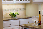 Granite countertop and tile backsplash in neutral palette