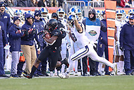 Philadelphia, PA - December 8, 2018: Army Black Knights running back Kell Walker (5) avoids Navy Midshipmen linebacker Diego Fagot (50) tackle during the 119th game between Army vs Navy at Lincoln Financial Field in Philadelphia, PA. (Photo by Elliott Brown/Media Images International)