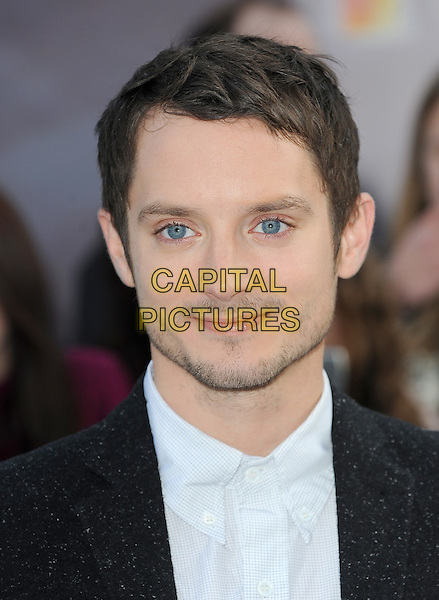 Elijah Wood.European Premiere of 'Happy Feet Two' at the Empire Leicester Square, London, England..November 20th 2011.headshot portrait black suit jacket white shirt stubble facial hair suit.CAP/BEL.©Tom Belcher/Capital Pictures.