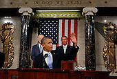 United States President Barack Obama waves to first lady Michelle Obama's box as he arrives to deliver his State of the Union Address on Capitol Hill in Washington January 28, 2014.     <br /> Credit: Larry Downing / Pool via CNP