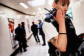 Police agent receive order for an incident inside London's Finsbury Park metro station. .Picture taken 2005 by Justin Jin