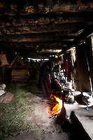 Inside the turf-roof summer house of a Bakarwal nomad family, high in the mountains above Naranag, Gangabal Lake region of Kashmiri Himalayas, India.