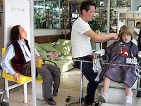 Lucas and Felix having their haircut at the barbershop in the condesa, Mexico City.