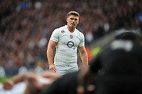 Owen Farrell of England watches a scrum. QBE International match between England and New Zealand on November 8, 2014 at Twickenham Stadium in London, England. Photo by: Patrick Khachfe / Onside Images
