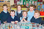 &nbsp;READING: Reading over some of the storybooks on their first day at Killahan National School, Abbeydorney, on Monday. L-r: Dylan Griffin, Domhnall Dowling, Emily and Amy Moriarty, Oisín Maunsell and Dylan Walsh. .<br />