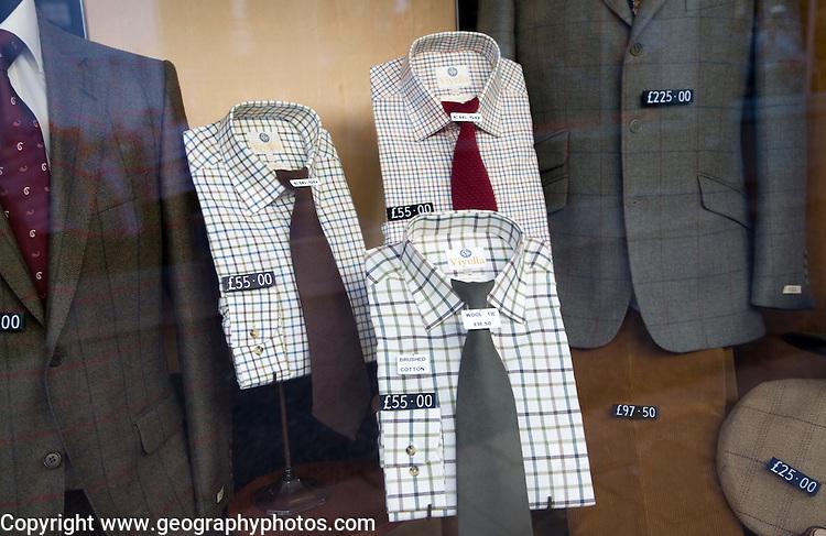 Viyella shirts smart jackets in gentlemans' clothing shop window display, Woodbridge, Suffolk, England