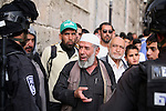 """Israeli policemen prevent Palestinians from entering the Al-Aqsa mosque compound in the Old City of Jerusalem on April 16, 2014. Dozens of Palestinians were wounded in clashes with Israeli police that erupted when Jerusalem's flashpoint Al-Aqsa mosque compound was opened to Jewish visitors. Palestinians threw """"stones and firecrackers"""" at police when they opened the walled compound's gates and Israeli police responded with stun grenades and rubber-coated bullets, they closed the complex to the Jewish visitors after a small number had toured the site. Photo by Saeed Qaq"""