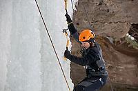 A female ice climber at Michigan Ice Fest near Munising Michigan.