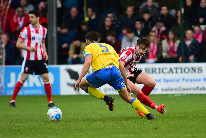 Lincoln City's Alex Woodyard vies for possession with Torquay United's Giancarlo Gallifuoco<br /> <br /> Photographer Andrew Vaughan/CameraSport<br /> <br /> Vanarama National League - Lincoln City v Chester - Tuesday 11th April 2017 - Sincil Bank - Lincoln<br /> <br /> World Copyright &copy; 2017 CameraSport. All rights reserved. 43 Linden Ave. Countesthorpe. Leicester. England. LE8 5PG - Tel: +44 (0) 116 277 4147 - admin@camerasport.com - www.camerasport.com