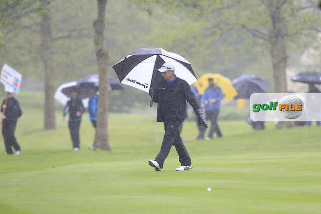 Paul McGinley (IRL) takes shelter from the rain on the 17th hole during Thursday's Round 1 of the 2016 Dubai Duty Free Irish Open hosted by Rory Foundation held at the K Club, Straffan, Co.Kildare, Ireland. 19th May 2016.<br /> Picture: Eoin Clarke | Golffile<br /> <br /> <br /> All photos usage must carry mandatory copyright credit (&copy; Golffile | Eoin Clarke)