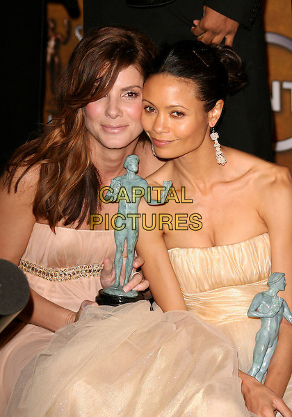 SANDRA BULLOCK & THADIE NEWTON.12th Annual Screen Actors Guild Awards (SAG) held at the Shrine Auditorium, Los Angeles, California, USA..January 29th, 2006.Photo: Zach Lipp/AdMedia/Capital Pictures.Ref: ZL/ADM.half length white strapless award trophy dress.www.capitalpictures.com.sales@capitalpictures.com.© Capital Pictures.