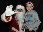 Conor McKenna pictured with Santa at the Castle Manor childrens Christmas party in the Rugby Club. Photo:Colin Bell/pressphotos.ie