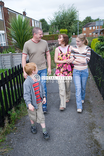 Family out walking down the street,