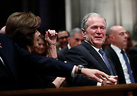 Former President George W. Bush smiles with former first lady Laura Bush during the State Funeral for former President George H.W. Bush at the National Cathedral, Wednesday, Dec. 5, 2018, in Washington.<br /> CAP/MPI/RS<br /> &copy;RS/MPI/Capital Pictures