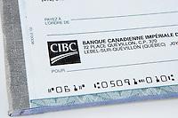 A CIBC cheque over a white background.