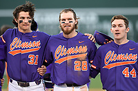 Right fielder Seth Beer (28), center, of the Clemson Tigers lines up with teammates to sing the school alma mater following the Reedy River Rivalry game against the South Carolina Gamecocks on Saturday, March 3, 2018, at Fluor Field at the West End in Greenville, South Carolina. Clemson won, 5-1. At left is Bryce Teodosio and at right is Ryley Gilliam. (Tom Priddy/Four Seam Images)