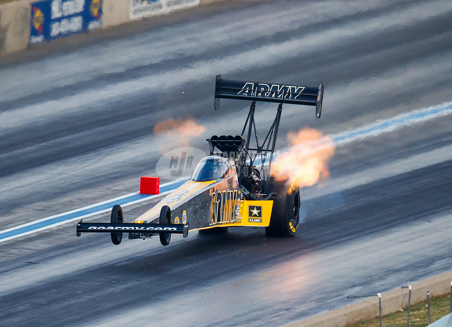 Jul 22, 2017; Morrison, CO, USA; NHRA top fuel driver Tony Schumacher does a wheelstand during qualifying for the Mile High Nationals at Bandimere Speedway. Mandatory Credit: Mark J. Rebilas-USA TODAY Sports