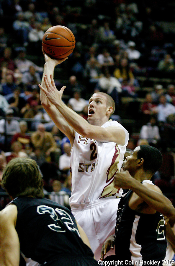 TALLAHASSEE, FL 11/3/09-FSU-DELTA BB09 CH19-Florida State's Jordan DeMercy puts a shot over Delta State's Dmitry Pirshin, left, and Roderick Ollie during second half action Tuesday at the Tallahassee-Leon County Civic Center. The Seminoles beat the Statesmen 81-38 in their first exhibition game of the season...COLIN HACKLEY PHOTO