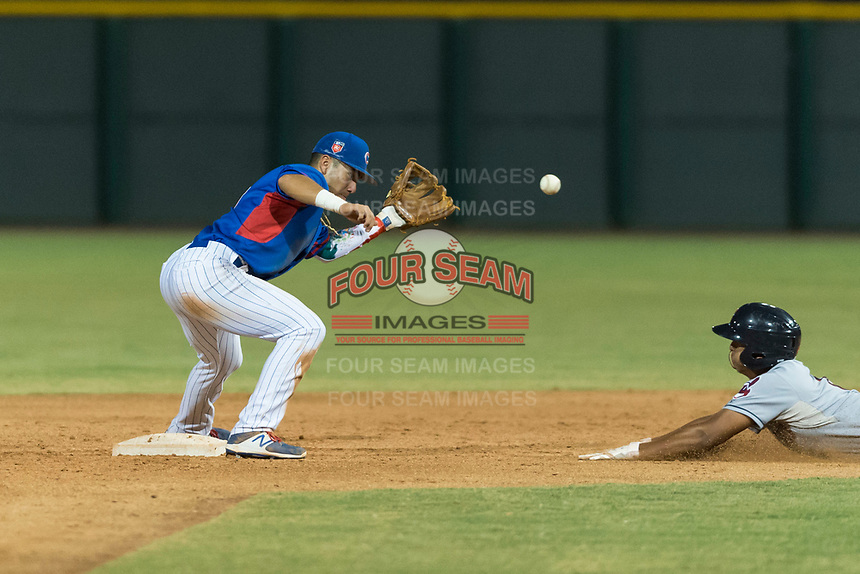AZL Cubs 2 second baseman Reivaj Garcia (24) prepares to catch a throw from the catcher on a stolen base attempt by Noah Naylor (12) during an Arizona League game against the AZL Indians 2 at Sloan Park on August 2, 2018 in Mesa, Arizona. The AZL Indians 2 defeated the AZL Cubs 2 by a score of 9-8. (Zachary Lucy/Four Seam Images)