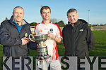 Capt of Pobal Scoil Chorcha Dhuibhne Padraig Ó Dubháin been presented with the O'Sullivan Cup on Wednesday in the Cluiche Ceannais Coláisti Chiarraí at Kerins O'Rahillys GAA Grounds as they beat St Brendans killarney by 4-7-1-6 by Fergus Clifford (chairman of College GAA) and also in pic Wheeshie Fogarty.