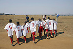 SOWETO, SOUTH AFRICA - SEPTEMBER 15: Unidentified boys celebrate after winning a soccer a game on September 15, 2007 in the Jabulani section Soweto, South Africa. Soccer is the most popular sport in South Africa, and a because of the upcoming World Cup 2010 in South Africa the interest is increasing. It's the first time the World Cup will be held on the African continent. South Africa doesn't have an organized youth soccer program and many teams and players struggle with lack of funds, to buy equipment and money for transport to games. .(Photo by Per-Anders Pettersson)....