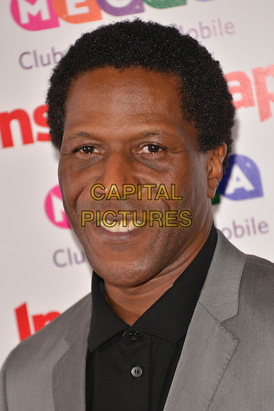Cornell S. John<br /> Inside Soap Awards at Ministry Of Sound, London, England.<br /> 21st October 2013<br /> headshot portrait black shirt jacket grey gray <br /> CAP/PL<br /> &copy;Phil Loftus/Capital Pictures