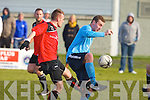 Park's Mark O'Sullivan and Kilbarrack United's Aaron Humphries go for the ball in the FAI Junior cup in Dublin on Sunday