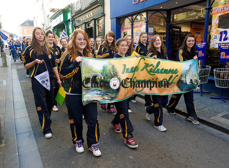 Inagh Kilnamona camogie players in the parade to Cusack Park for the Ireland V Scotland senior hurling shinty International game, to mark the official opening of Fr Mc Namara Memorial Park in Doora. Photograph by John Kelly.