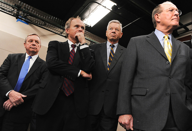 "UNITED STATES - NOVEMBER 16:  From left, Senate Majority Whip Richard Durbin, D-Ill., Reps. Charlie Bass, R-N.H., Tom Petri, R-Wis., and Senate Republican Conference Chair Lamar Alexander, R-Tenn.,  attend a bipartisan, bicameral news conference in the Capitol Visitor Center to call on the Joint Select Committee on Deficit Reduction, also known at as the Super Committee, to ""go big"" on their plan to reduce the national deficit.  (Photo By Tom Williams/CQ Roll Call)"
