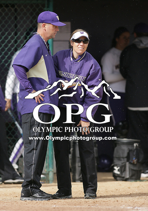 23 May 2010:  Washington Huskies head coach Heather Tarr and assistant coach Lance Glasoe chat before the game against the University of North Carolina.  Washington defeated the University of North Carolina 2-1 in eight innings at Husky Softball Stadium in Seattle, WA to advance in the NCAA regional tournament.