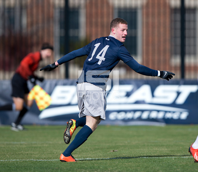 Cole Seiler (14) of Georgetown celebrates his game-opening goal during the second round of the NCAA tournament at Shaw Field in Washington, DC. Georgeotown defeated Old Dominion, 3-0.