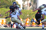 Beverly Hills, CA 09/23/11 - Ashton Jones (Peninsula #58) and unknown Beverly Hills player(s) in action during the Peninsula-Beverly Hills frosh football game at Beverly Hills High School.