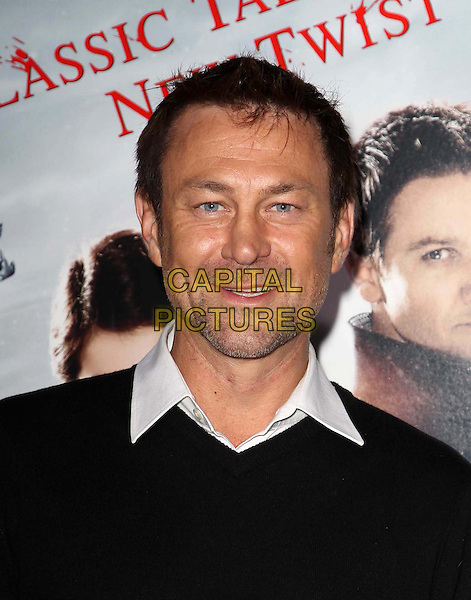 Grant Bowler.attending the Paramount Los Angeles film premiere of 'Hansel and Gretel: Witch Hunters', held at The Grauman's Chinese Theater in Hollywood, California, USA, January 24th 2013..portrait headshot stubble facial hair black jumper white shirt .CAP/ADM/KB.©Kevan Brooks/AdMedia/Capital Pictures.