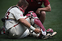 NWA Democrat-Gazette/J.T. WAMPLER  Grant Koch holds his ankle Sunday May 13, 2018 after injuring himself during the Razorback's game against Texas A&M.