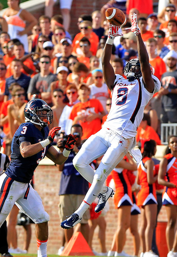 Richmond wide receiver Rashad Ponder (8) makes a catch next to Virginia safety Quin Blanding (3) during the game Saturday Sept. 6, 2014 at Scott Stadium in Charlottesville, VA. Virginia defeated Richmond 45-13. Photo/Andrew Shurtleff