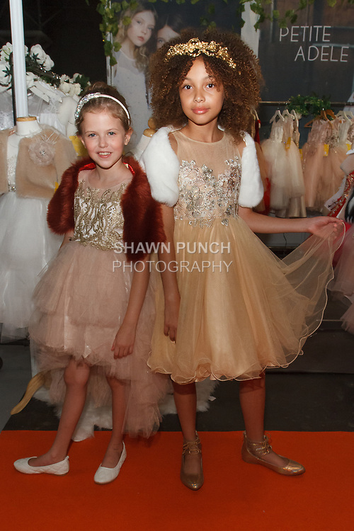 Models pose in outfits from the Petite Adele collection by Sam Na, for the petitePARADE Spring Summer 2018 fashion show with Children's Club, at Javits Center in New York City, on August 7, 2017.