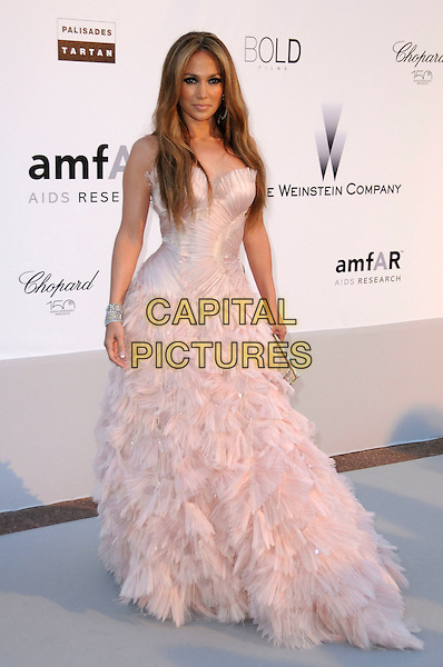JENNIFER LOPEZ.arrivals at amfAR's Cinema Against AIDS 2010 benefit gala at the Hotel du Cap, Antibes, Cannes, France during the Cannes Film Festival.20th May 2010.amfAR full length strapless peach pale pink tulle gown dress long maxi ballgown silk ruffles ruffle .CAP/CAS.©Bob Cass/Capital Pictures.