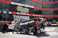 Jun 21, 2015; Bristol, TN, USA; Crew members push NHRA funny car driver Cruz Pedregon towards the burnout box  during the Thunder Valley Nationals at Bristol Dragway. Mandatory Credit: Mark J. Rebilas-