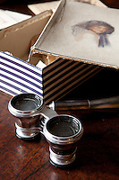 A pair of antique opera glasses is amongst the family memorabilia in the Colonel's Room