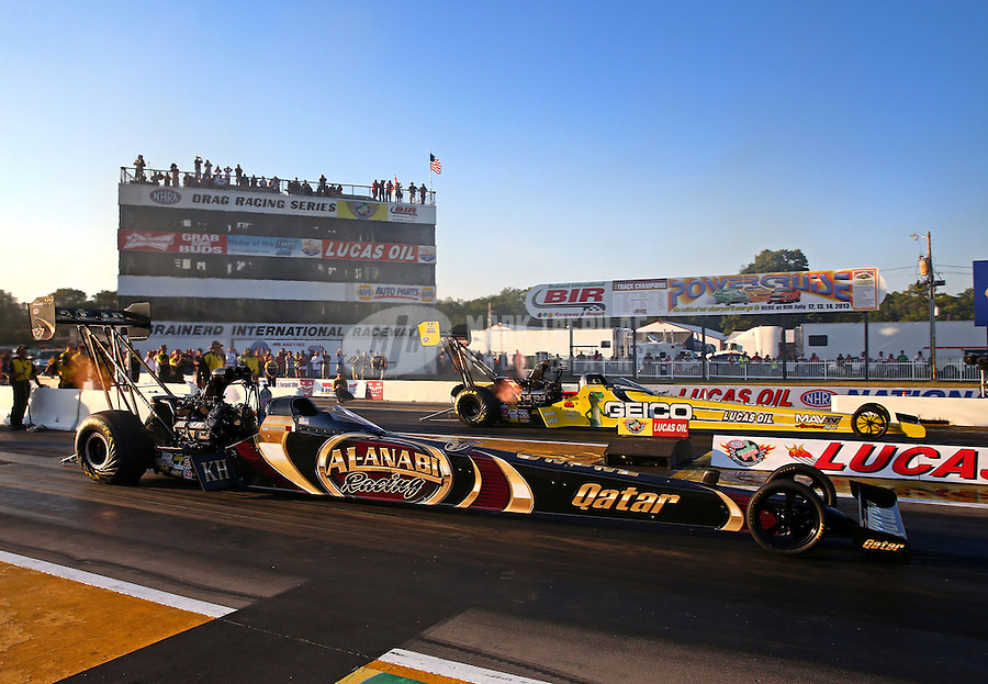 Aug. 16, 2013; Brainerd, MN, USA: NHRA top fuel dragster driver Khalid Albalooshi (near lane) races alongside Morgan Lucas during qualifying for the Lucas Oil Nationals at Brainerd International Raceway. Mandatory Credit: Mark J. Rebilas-